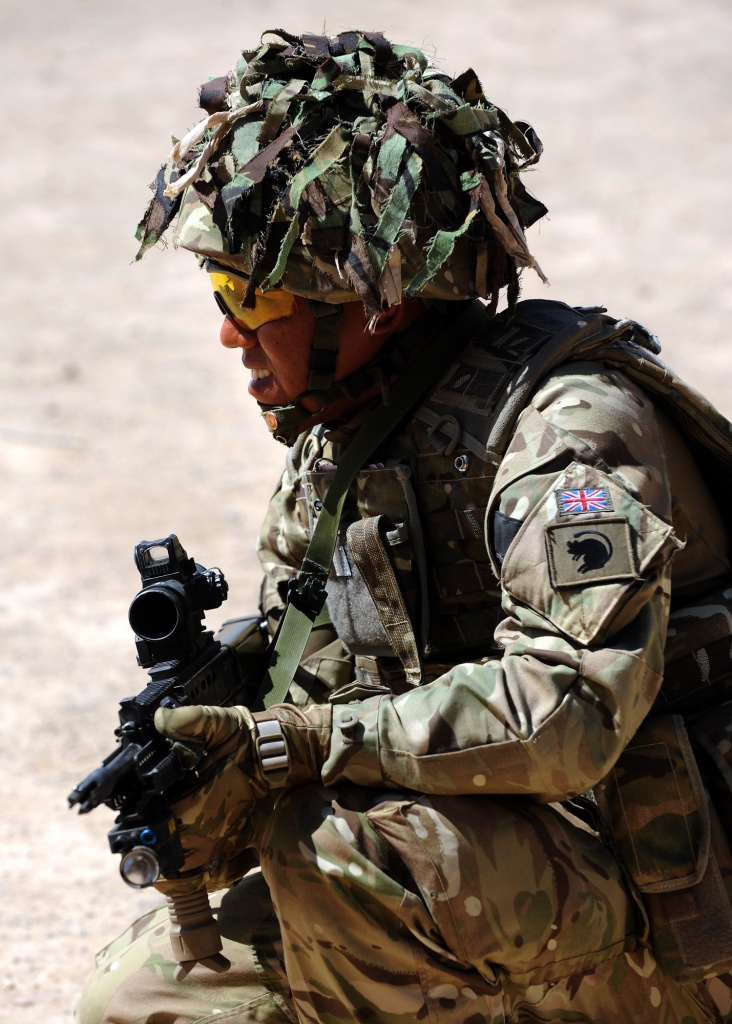 A soldier with the 4th Mechanized Brigade otherwise known as the 'Black Rats' is pictured taking part in a RSOI (Reception, Staging and Onward Integration) exercise having just arrived in Afghanistan. Day 5 on the RSOI is a mock Patrol Base Exercise. The soldiers are split into multiples and have to practice all drills taught throughout the week in order to conduct a shura in the mock village of Wahim Kalay.